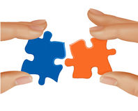 Hands and puzzle. Business concept. Royalty Free Stock Photography