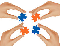 Hands and puzzle. Business concept. Stock Photography