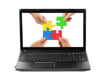 Hands and puzzle in computer notebook Stock Photos