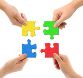 Hands and puzzle. Isolated on white background stock photo
