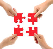 Hands and puzzle. Isolated on white background royalty free stock photos
