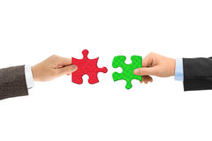 Hands and puzzle Stock Image