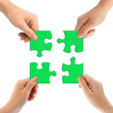 Hands and puzzle. Isolated on white background royalty free stock images