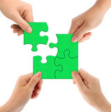 Hands and puzzle. Isolated on white background royalty free stock photography