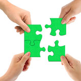 Hands and puzzle. Isolated on white background royalty free stock photo