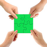 Hands and puzzle. Isolated on white background stock photography