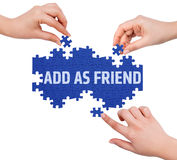 Hands with puzzle making ADD AS FRIEND word Royalty Free Stock Images