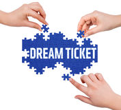 Hands with puzzle making DREAM TICKET word Stock Photography