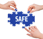 Hands with puzzle making SAFE word Stock Image