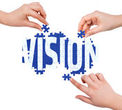 Hands with puzzle making VISION word Royalty Free Stock Photography