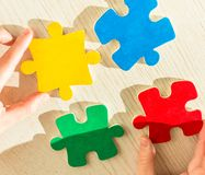 Hands with puzzle pieces. Concept Royalty Free Stock Photos