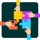 Hands with puzzle pieces. Hands moving colorful jigsaw puzzle pieces on black Stock Photos