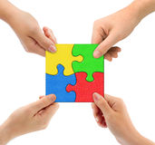 Hands and puzzle Team. Isolated on white background stock image