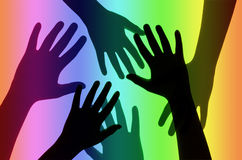 Hands on Rainbow Background. Royalty Free Stock Photos