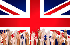 Hands Raised With British Flag As A Background Royalty Free Stock Images