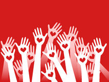 Hands raised with hearts. On red background Royalty Free Stock Photo