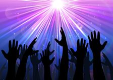 Hands raised from the people with light colourful Stock Photography