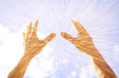 Hands raised in prayer against sky. double exposure effect Stock Photo