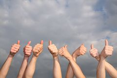 Hands with the raised thumbs Royalty Free Stock Photos