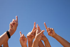 Hands raised to the sky Stock Photo