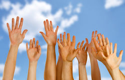 Hands raised up in air royalty free stock photography