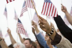 Hands Raising American Flag Royalty Free Stock Photo