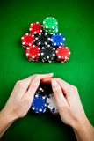 Hands rakes up gambling chips. Female hands rakes up stack of gambling chips stock photography
