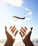 Hands reach for airplane Royalty Free Stock Photos