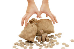 Hands reach for bags with coins Stock Photography