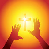 Hands reach out to cross in bright light Stock Image