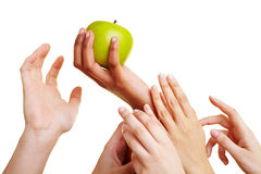 Hands reaching for an apple royalty free stock image