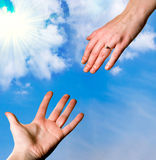 Hands reaching for each othe Stock Photo
