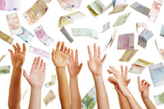 Hands reaching for flying Euro money Stock Photography