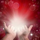 Hands. Reaching, in front of circles and stars red background Stock Photos