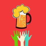 Hands reaching for a glass of beer Stock Image