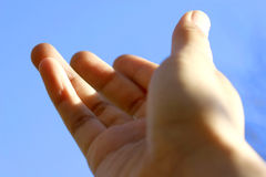 Hands reaching out. Towards faith and appreciation