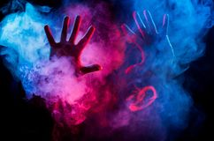 Male hands from colorful smoke Stock Photography