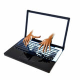 Hands reaching out of laptop screen Stock Photo