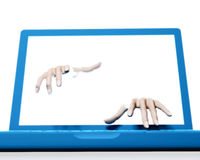 Hands reaching out of laptop screen Royalty Free Stock Photo