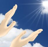 Hands reaching out  the sun Stock Image