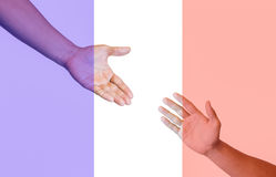 Hands reaching for peace and pray Stock Image