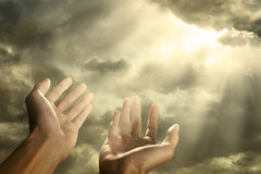 Hands reaching for the sky. Hands of a man reaching to towards sky Stock Photo