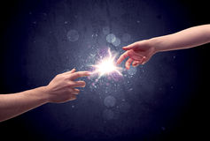 Hands reaching to light a spark Royalty Free Stock Photo