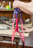 Hands of real bicycle mechanic sanding frame bike Royalty Free Stock Photography