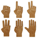 Hands recycled paper craft. Stick on white background stock photos