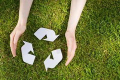 Hands with Recycling Sign on Grass Royalty Free Stock Photo