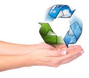 Hands and recycling symbol Stock Photos