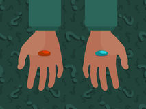 Hands with the red and blue pills Royalty Free Stock Photo