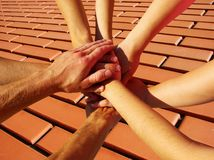 Hands on red brick Royalty Free Stock Image