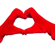 Hands in red gloves show heart shaped sign on white isolated bac Royalty Free Stock Image